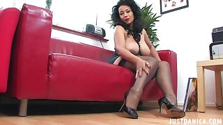 Disingenuous cougar Danica Collins nearby high heels playing on the sofa