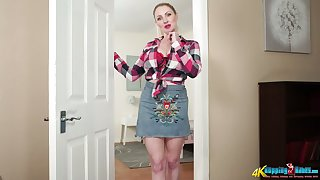 Busty pale blonde nympho Georgie Lyall slowly strips and flashes obese tits